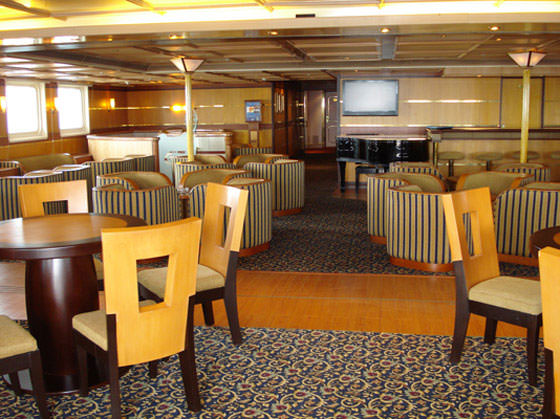 Before: The Piano Bar on Deck 4 in her Galapagos Explorer II days (1998-2013). Aaron Saunders' Collection