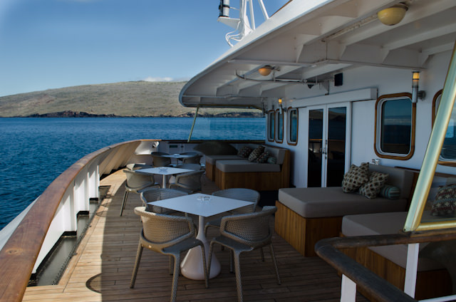 Looking for a nice quiet place to take that book and a glass of wine? Try the excellent outdoor deck aft of the Piano Bar, Deck 4. Photo © 2014 Aaron Saunders