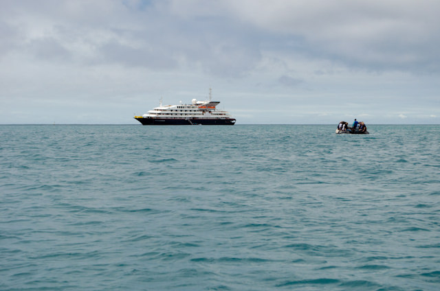 Approaching the gorgeous Silver Galapagos at anchor off San Cristobal. Photo © 2014 Aaron Saunders