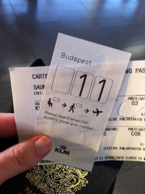 Schiphol Nightmare: a new numbered boarding system was being tested at Amsterdam Airport Schiphol's C Gates. I got Lucky 11. Sadly, the system didn't work, infuriated passengers, and delayed boarding. C'est la vie. Photo © 2014 Aaron Saunders
