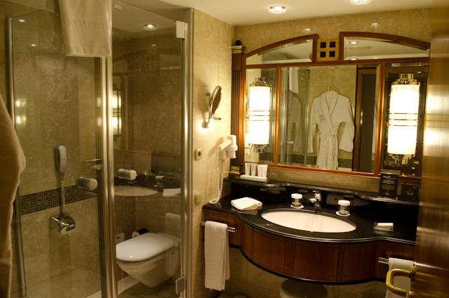 Marble-clad bathrooms feature compartmentalized showers, toilets, and a separate bath tub. Photo © 2014 Aaron Saunders