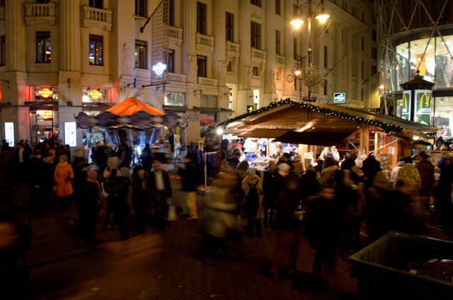By night, the markets are quite busy. Budapest is a reasonably safe city, but watch your personal belongings at night in crowds like this! Photo © 2014 Aaron Saunders