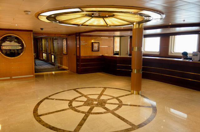 The welcoming Reception Area aboard Silversea's Silver Galapagos, facing port / aft. Photo © 2014 Aaron Saunders