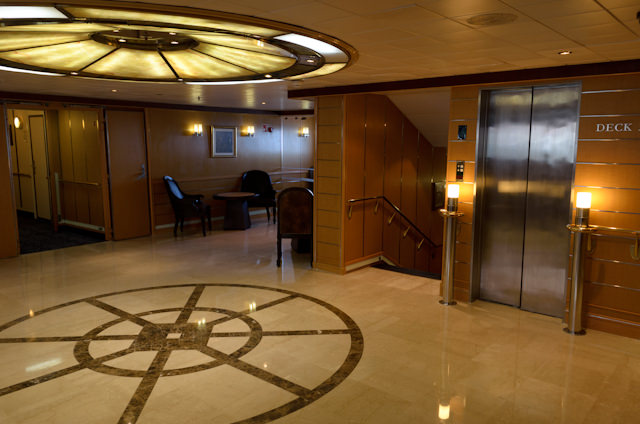 Off to the starboard side of the reception area is the ship's central staircase and elevator. Photo © 2014 Aaron Saunders