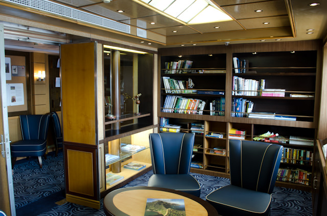 Relax with a book in the well-stocked Library aboard Silver Galapagos. Photo © 2014 Aaron Saunders