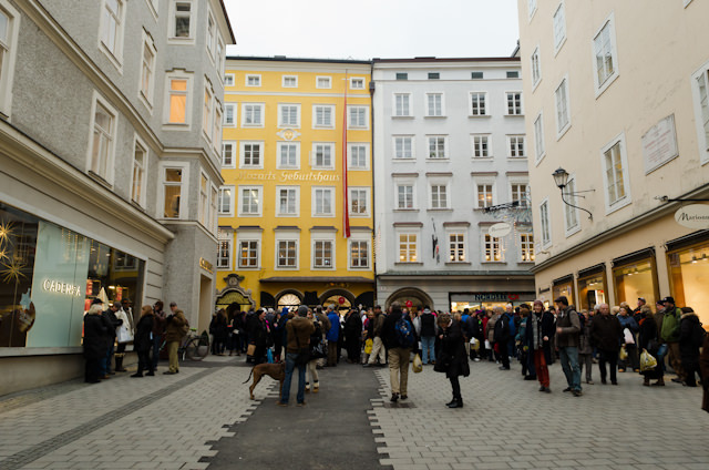 Our meeting place next to Mozart's birthplace, the yellow building on the left. Photo © 2014 Aaron Saunders