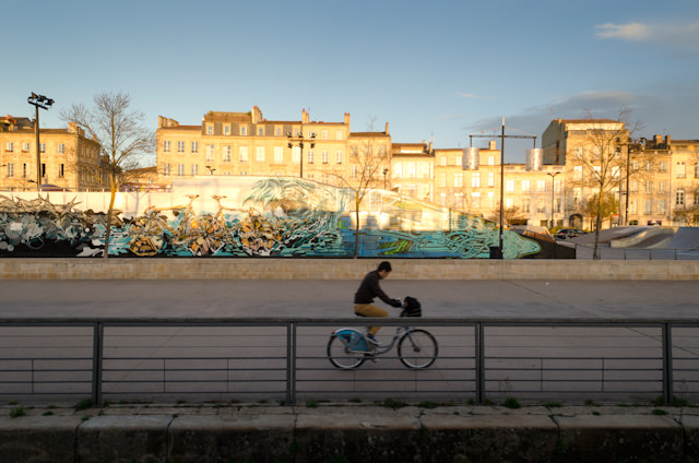 A cyclist zips past the Viking Forseti in Bordeaux in the early morning hours of November 28, 2014. Photo © 2014 Aaron Saunders