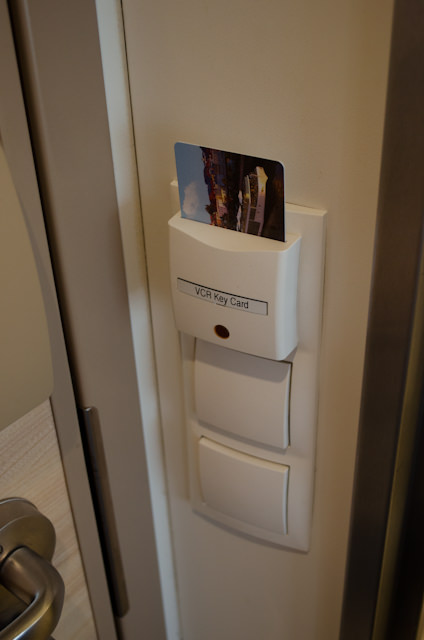 Your keycard controls the lighting in your stateroom, but power outlets and the television will remain on without it. Photo © 2014 Aaron Saunders