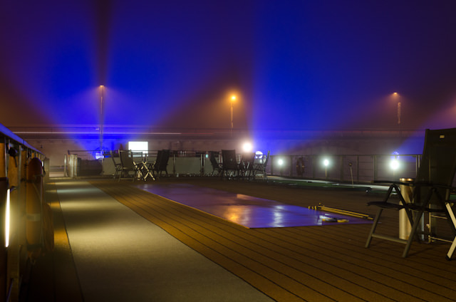 Libourne's futuristic-yet-medieval bridge, lit with volumetric lighting in the fog. Photo © 2014 Aaron Saunders