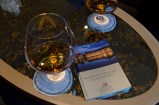 Enjoying a pre-dinner drink in The Lounge. Also pictured is the amazingly-useful destination booklet that Viking provides to each guest with their cruise documents. Photo © 2014 Aaron Saunders