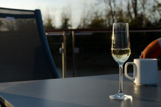 A good compromise: champagne on the Sun Deck as the evening turns into one of the most gorgeous of the voyage so far. Photo © 2014 Aaron Saunders