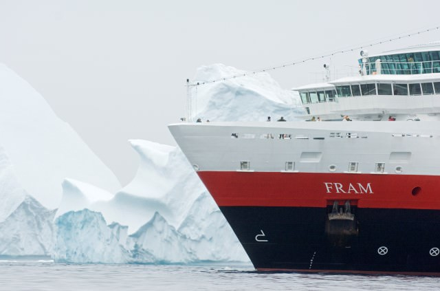 Hurtigruten's FRAM stands out against the monochromatic colors of Antarctica. Photo courtesy of Hurtigruten.