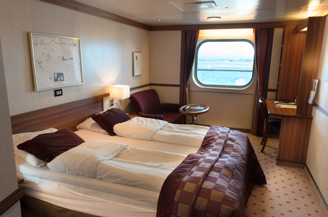 These Category F2 staterooms are spacious and inviting, and provide a generous amount of living space. Photo © 2015 Aaron Saunders