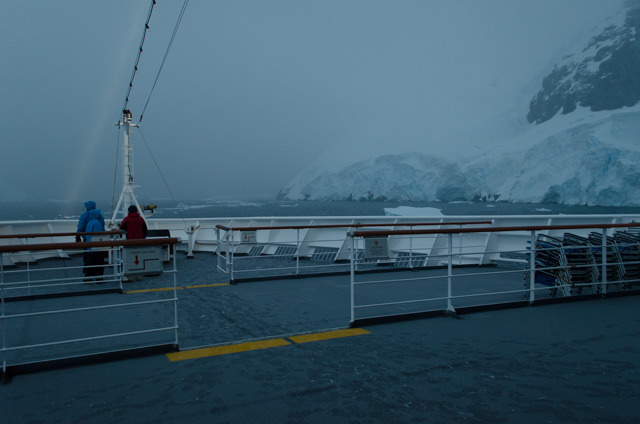 Late this evening, Hurtigruten's FRAM sailed through the Lemaire Channel under heavy fog. Photo © 2015 Aaron Saunders