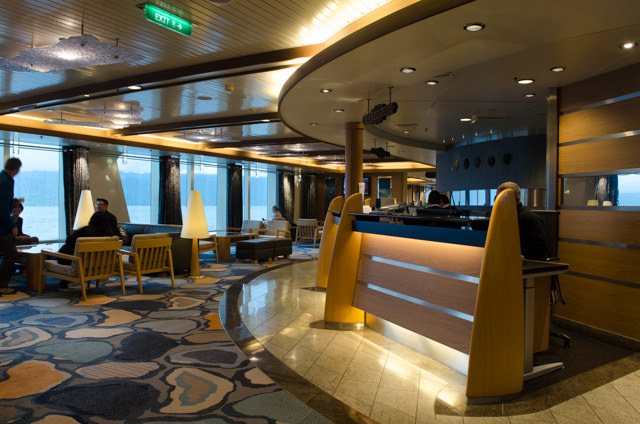 My first look at Hurtigruten's beautiful FRAM: the Reception Lobby on Deck 4, facing aft. Photo © 2015 Aaron Saunders