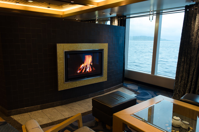 There's even a faux fireplace on Deck 4 just off the Reception Lobby that's quite cozy. Photo © 2015 Aaron Saunders