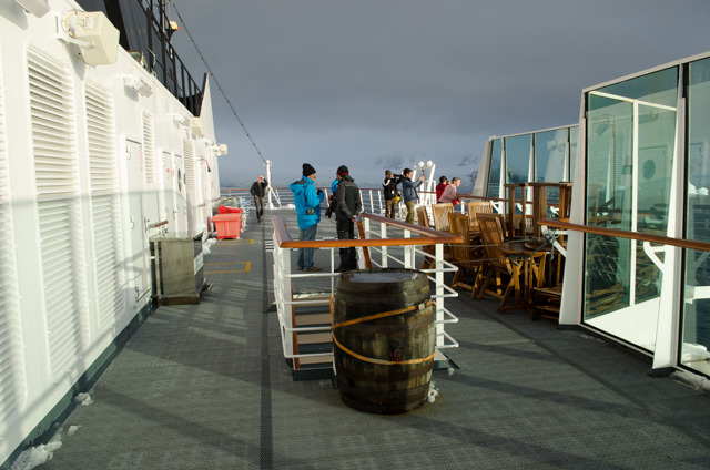 Guests take in the sun from up on Deck 7...Photo © 2015 Aaron Saunders