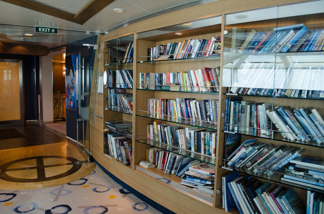 Books in the Library on the starboard side of the Observation Lounge, Deck 7. Photo © 2015 Aaron Saunders