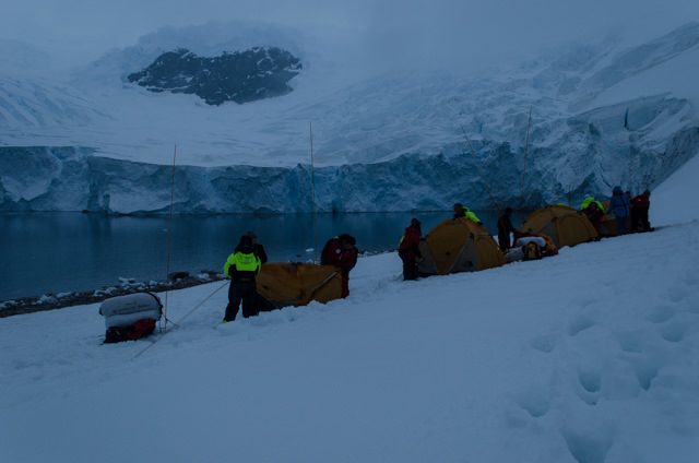 Building camp. This photo was taken just before the entire face of the glacier in the background crashed into the water. Photo © 2015 Aaron Saunders