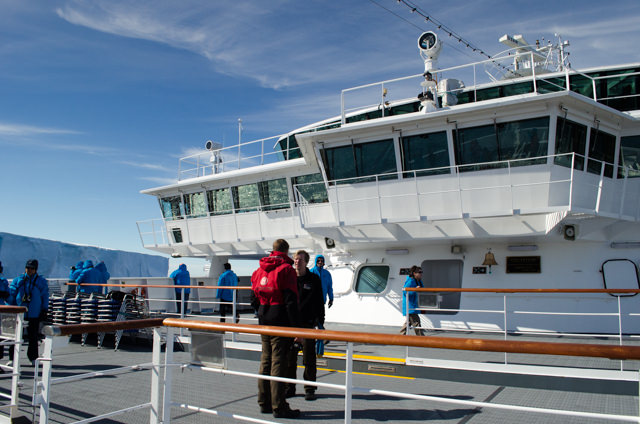The open bow viewing area on Deck 5 became the place to be as Hurtigruten's FRAM neared the Antarctic Peninsula. Photo © 2015 Aaron Saunders