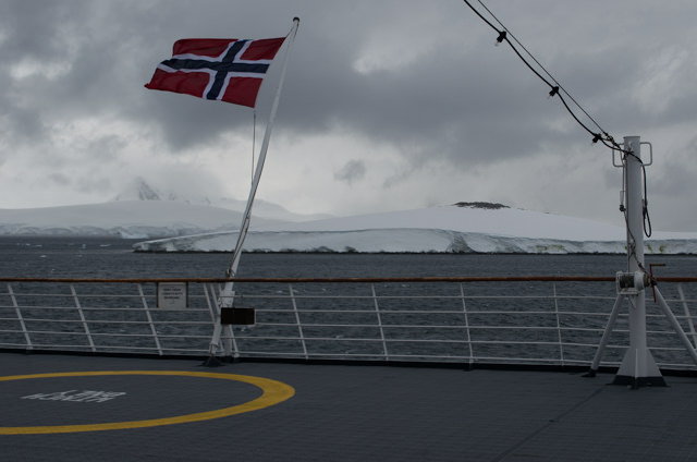 ...provided a stark contrast to the nasty weather outside. Notice the rigidity of the Norwegian flag; the wind was that strong! Photo © 2015 Aaron Saunders