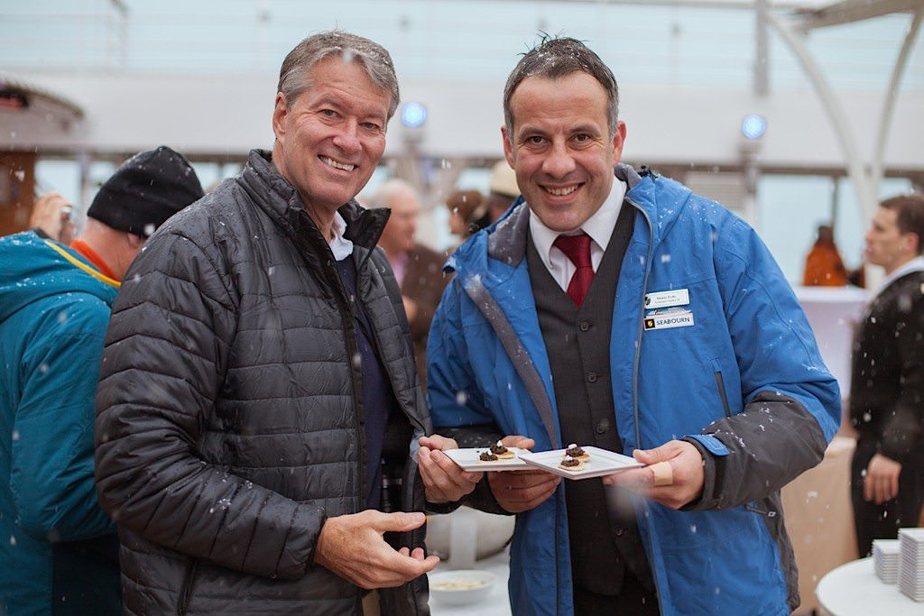 Caviar on the sun deck: Ralph Grizzle with Seabourn Quest Assistant Maitre'd Damir Pedic, cruising Antarctica this past December. © 2014 Avid Travel Media Inc.