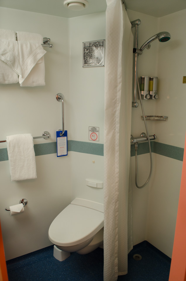The bathroom of my Category 8C Balcony Stateroom features a toilet, shower...Photo © 2015 Aaron Saunders