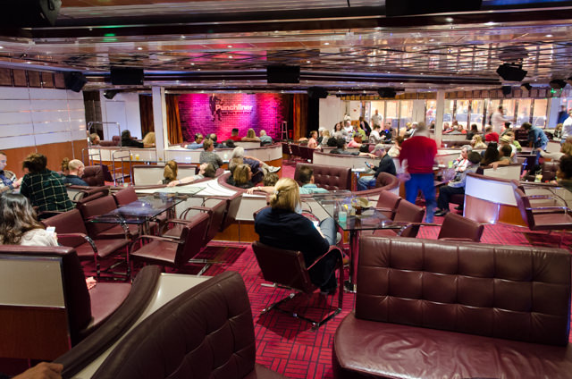 Guests take in FOUR Punchliner Comedy Club shows in the International Lounge on Deck 5. One is clean, and five were deliciously 18+. Photo © 2015 Aaron Saunders
