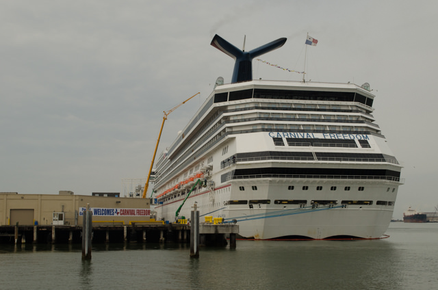 Carnival Freedom docked in Galveston on Sunday, February 15, 2015. The large yellow crane at left is removing pieces of the stage from the Martina McBride concert. Photo © 2015 Aaron Saunders