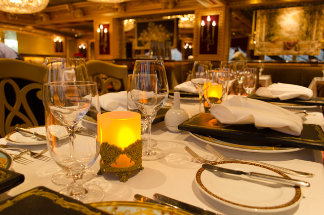The Sun King Steakhouse takes on a particularly elegant ambiance at night. Photo © 2015 Aaron Saunders