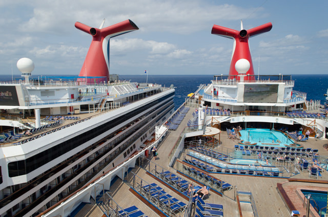 The upper decks of Carnival Liberty, left, and Carnival Freedom, right. Photo © 2015 Aaron Saunders