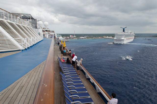 With winds picking up, we slowly maneuver away from Carnival Liberty and Cozumel. Photo © 2015 Aaron Saunders