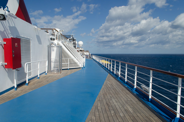 Burning off the calories on Carnival Freedom's jogging track, Deck 11 aft. Photo © 2015 Aaron Saunders