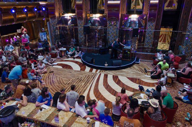 Disney Trivia in the Millennium Atrium this afternoon, hosted by cruise director Jen Baxter. Photo © 2015 Aaron Saunders