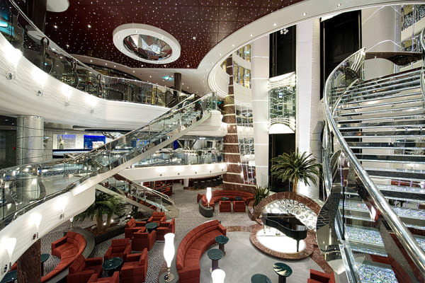 MSC Divina's glittering atrium. The two sweeping staircases are inset with Swarovski crystals. Photo courtesy of MSC Cruises