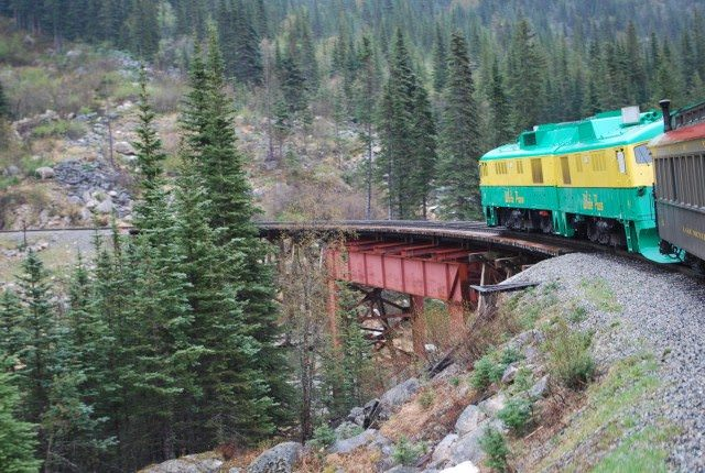 White Pass and Yukon Railroad locomotive pulling up the long grade to the summit