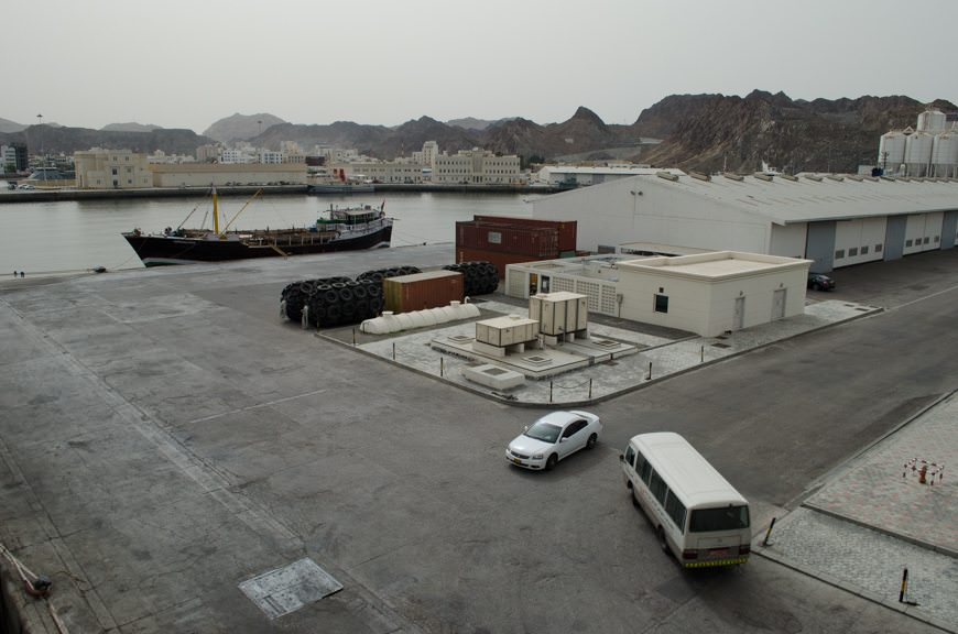 The Port of Muscat is industrial in nature, but still boasts a modern cruise terminal (off-screen). Photo © 2015 Aaron Saunders