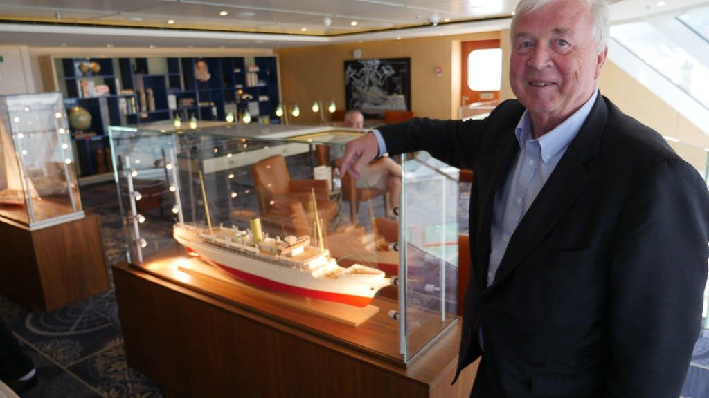 On Viking Star Torstein Hagen stands beside a model from the fleet of Bergen Line, where he began his career in the 1970s. © 2015 Ralph Grizzle