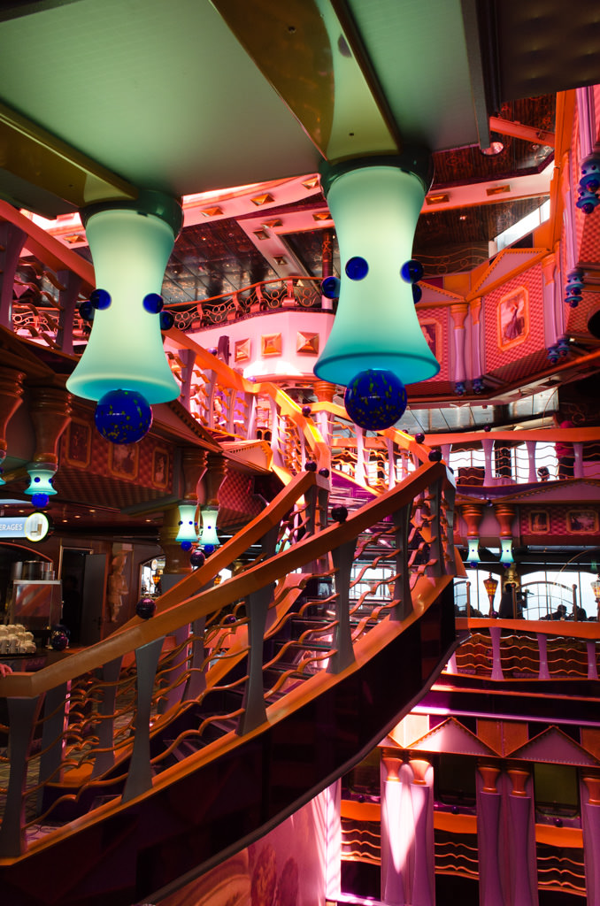 Whimsical lighting can be found throughout Carnival Miracle, like these blue ceiling lamps that adorn the Deck 9 landings around the central atrium. The staircase leads up to Nick and Nora's Steakhouse, located in the base of Carnival's iconic funnel. Photo © 2015 Aaron Saunders