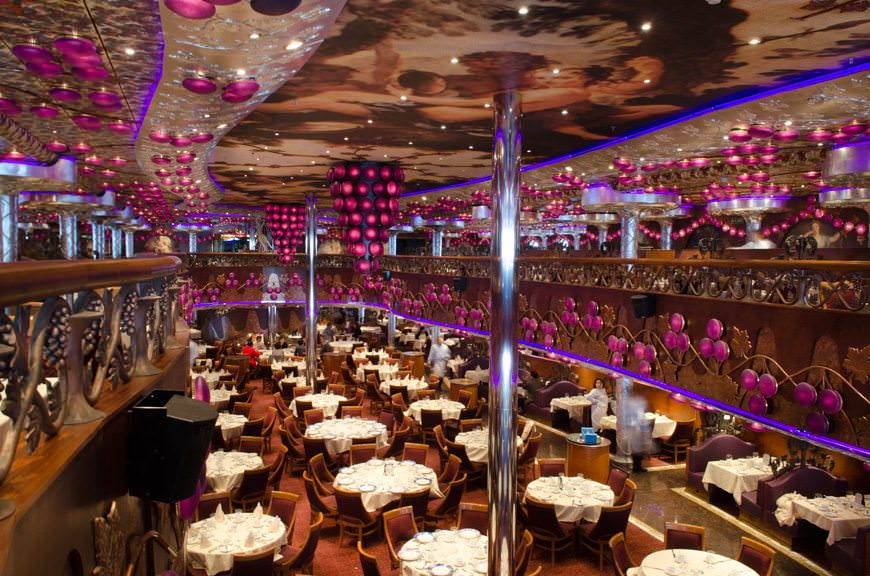 Unlike other Carnival ships, which have traditionally featured two main dining rooms, Carnival Miracle has one: the two-story Bacchus Dining Room on Decks 2 and 3 aft. Photo © 2015 Aaron Saunders