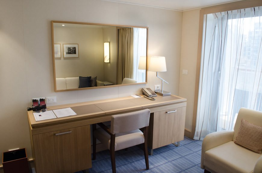 The vast majority of rooms feature a large writing desk and built-in vanity. The mini-bar is cleverly hidden in a EUROPA 2-style drawer to the right. Photo © 2015 Aaron Saunders