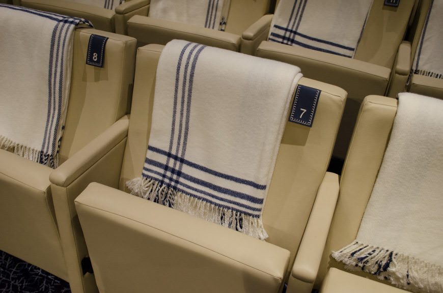 Cozy blankets adorn chairs in The Cinema. Photo © 2015 Aaron Saunders