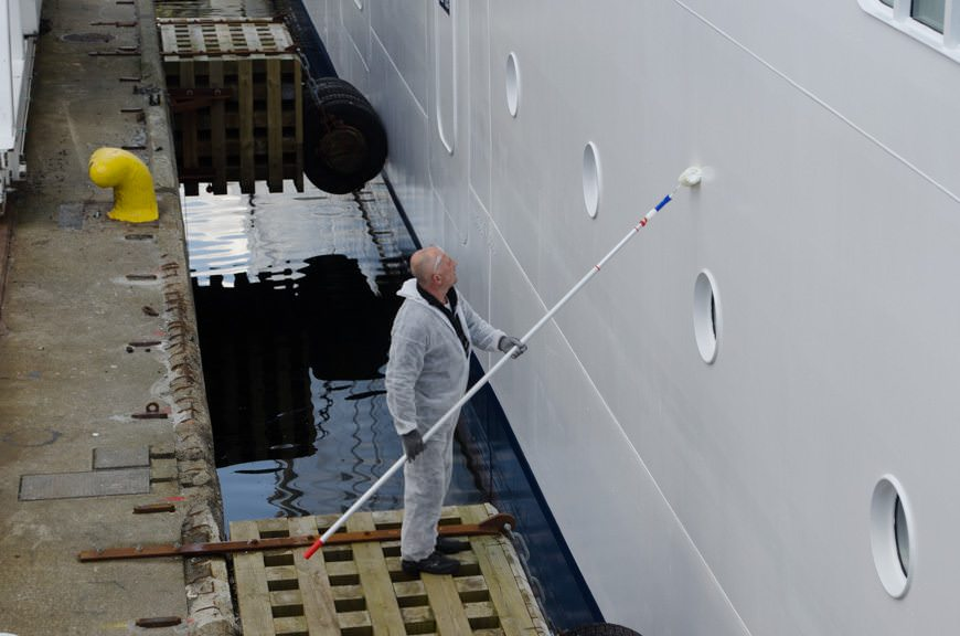 Touching up the paint on Viking Star as she readies for her christening. Photo © 2015 Aaron Saunders