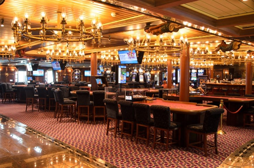 Mr. Lucky's Casino is actually rather attractive for a shipboard casino, and features numerous nautical elements. The Casino Bar is also unusually welcoming, and there's no trace of cigarette smoke. Photo © 2015 Aaron Saunders
