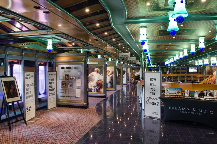 The Photo Gallery runs along the port and starboard sides of the atrium on Deck 3, making it one of the only real choke points aboard the ship. Photo © 2015 Aaron Saunders