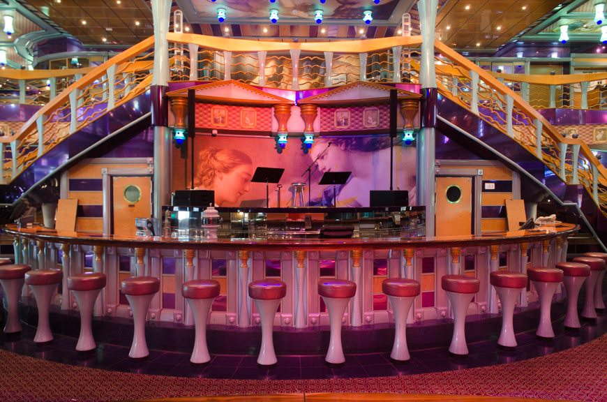 The main Bar in the Metropolis Atrium is a popular social hub, and features live music on the stage above and behind the bar in the evening. Photo © 2015 Aaron Saunders