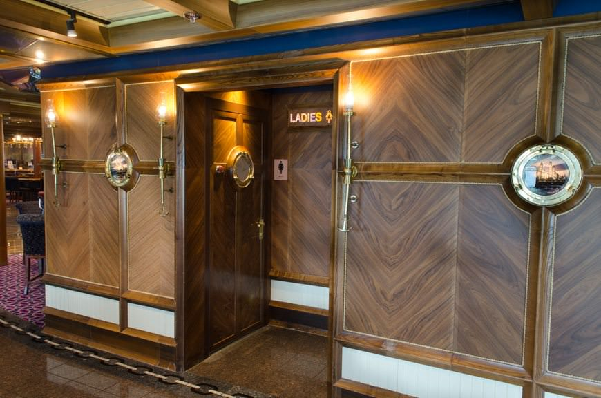 Casino Details: note the nautical touches on the entranceways to the public washrooms on the starboard side of Mr. Lucky's Casino. Photo © 2015 Aaron Saunders