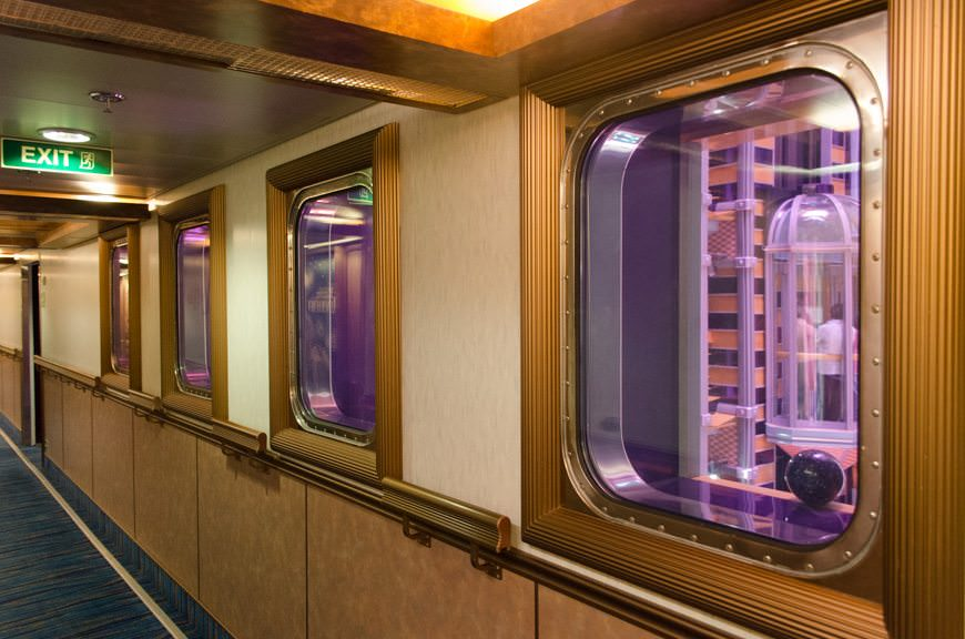Guest corridors amidships feature windows that look out over the Metropolis Atrium. It's a nice touch to accent what would otherwise be a boring stateroom hallway. Photo © 2015 Aaron Saunders