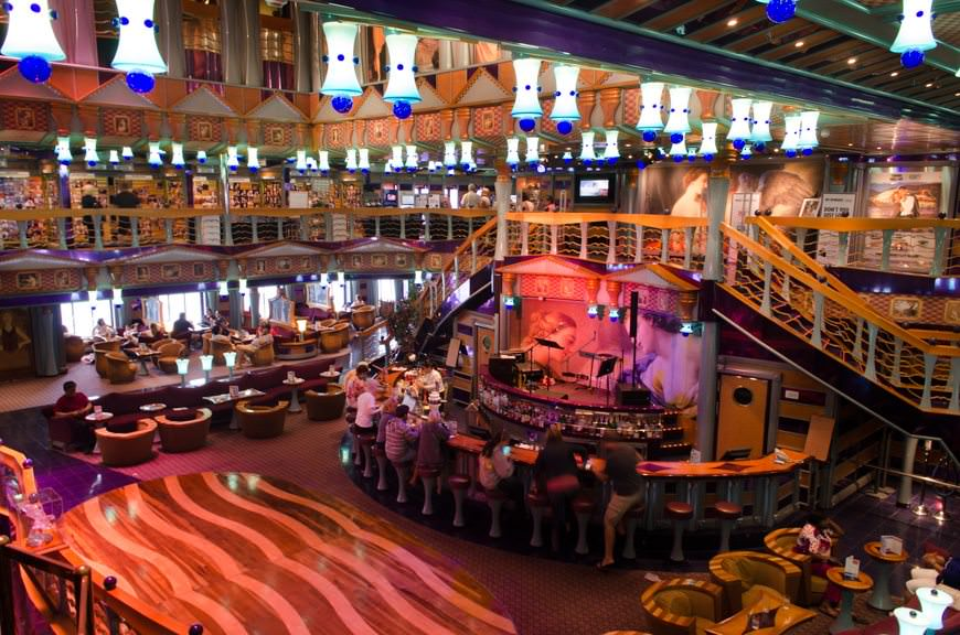 Guests aboard Carnival Miracle enjoy one last afternoon of fun and leisure in the Atrium Bar on Deck 2. Photo © 2015 Aaron Saunders
