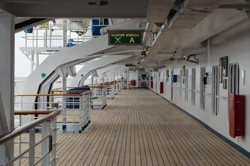I love Carnival Miracle's wide, open, nearly wrap-around promenade. Photo © 2015 Aaron Saunders